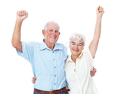 Buy stock photo Studio portrait of an elderly couple with their arms raised in celebration isolated on white