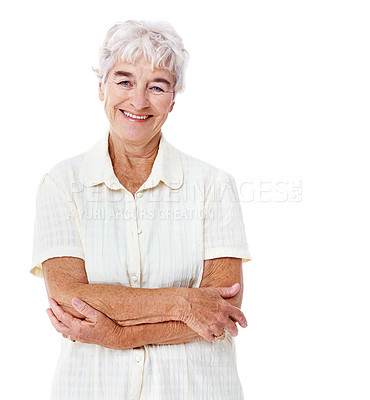 Buy stock photo Studio portrait of a smiling elderly woman standing with her arms crossed isolated on white