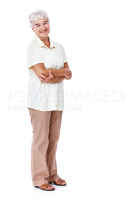 Buy stock photo Full length studio portrait of a smiling elderly woman standing with her arms crossed isolated on white
