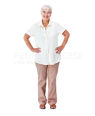 Buy stock photo Full length studio portrait of a smiling elderly woman standing with her hands on her hips isolated on white