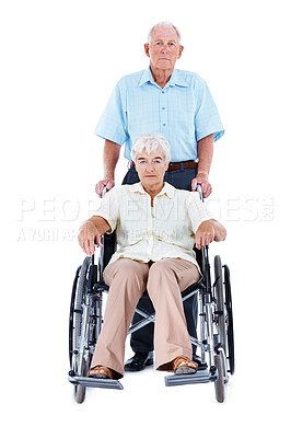 Buy stock photo Full length studio portrait of an elderly woman in a wheelchair with her husband standing beside her isolated on white