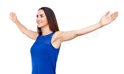 Buy stock photo Cropped shot of an attractive young woman standing with her arms outstretched against a white background
