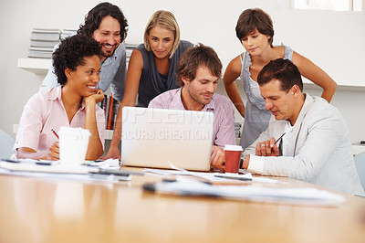 Buy stock photo Leader with his team working on the business plan