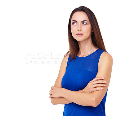Buy stock photo Cropped shot of an attractive young woman standing with her arms folded and looking thoughtful