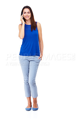 Buy stock photo Full length portrait of an attractive young woman talking on her cellphone against a white background