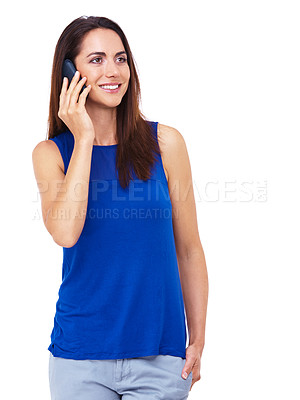 Buy stock photo Shot of an attractive young woman talking on her cellphone against a white background