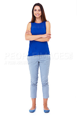 Buy stock photo Full length shot of an attractive young woman standing with her arms folded against a white background