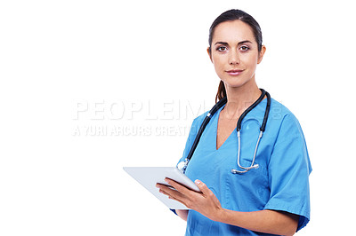 Buy stock photo Portrait of an attractive young nurse using a digital tablet against a white background
