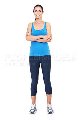 Buy stock photo Full length shot of a sporty young woman standing with her arms folded against a white background