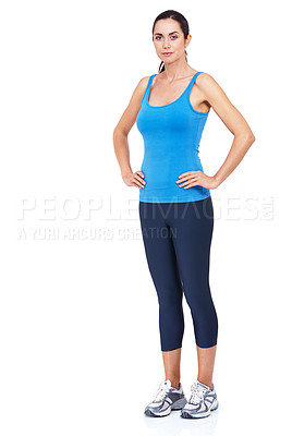 Buy stock photo Full length shot of a sporty young woman standing with her hands on her hips against a white background