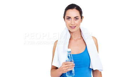Buy stock photo Cropped shot of an attractive young woman standing with a towel around her neck and holding a bottle of water