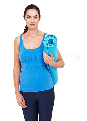 Buy stock photo Cropped shot of an attractive young woman holding an exercise mat against a white background