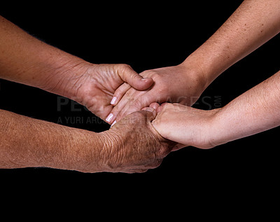 Buy stock photo Closeup studio shot of an elderly man and young woman holding hands