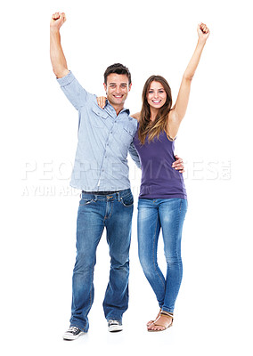 Buy stock photo Shot of a smiling couple against a white background with their arms in the air