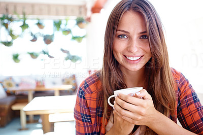 Buy stock photo Portrait of a smiling woman in a coffee shop holding a cup of coffee