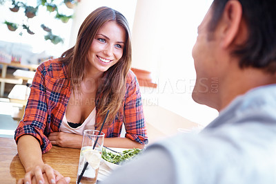 Buy stock photo Shot of a couple out for lunch and holding hands across the restuarant table