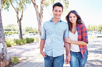Buy stock photo Shot of a loved up couple going for a romantic walk with copyspace