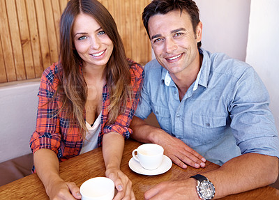 Buy stock photo Portrait of a happy couple having a coffee date