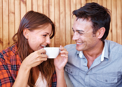 Buy stock photo Shot of a loved up couple on a date drinking coffee together