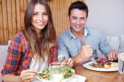 Buy stock photo Portrait of a happy couple having lunch together at a restuarant
