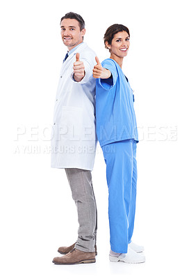 Buy stock photo Shot of a doctor and nurse standing back to back holding a thumbs up sign against a white background