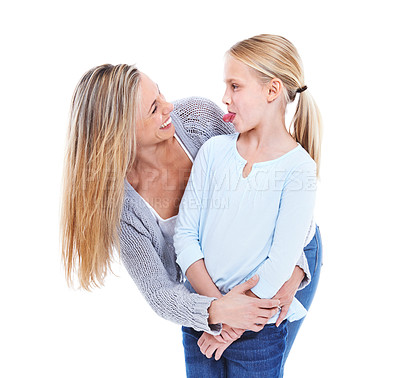 Buy stock photo Studio shot of a mother hugging her daughter against a white background