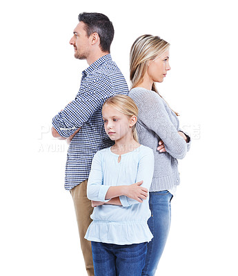 Buy stock photo Studio shot of a serious family consisting of a mother, daughter and father standing back to back with their arms folded