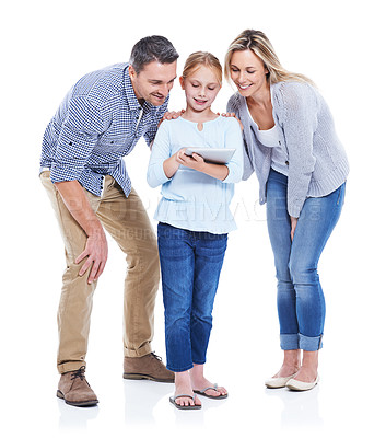 Buy stock photo Studio shot of a happy family looking at a touchscreen against a white background