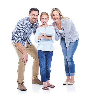 Buy stock photo Studio shot of a happy family looking at a touchscreen against a white background and smiling at the camera