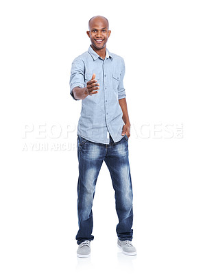Buy stock photo A smiling african american man offering his hand towards you in friendship while isolated on white