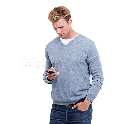 Buy stock photo A handsome man using his smartphone while isolated on white