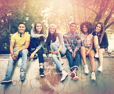 Buy stock photo Portrait of a group of friends hanging out together in an urban setting