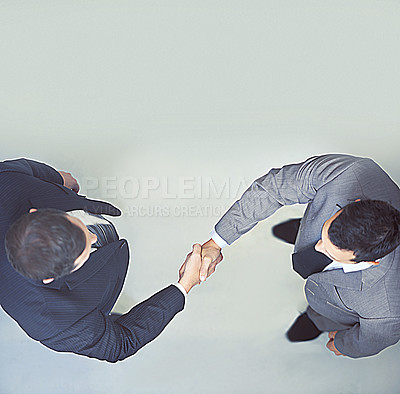 Buy stock photo Two businessmen shaking hands
