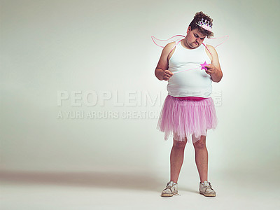 Buy stock photo An overweight man comically dressed-up in a pink fairy costume looking sad