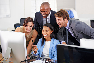 Buy stock photo Shot of a group of businesspeople working around a computer