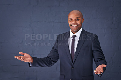Buy stock photo Portrait of a successful young businessman standing with his arms out
