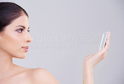 Buy stock photo Studio shot of a beautiful brunette woman against a gray background