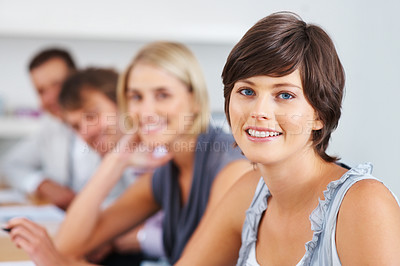 Buy stock photo Portrait of confident business woman with supporting team in background