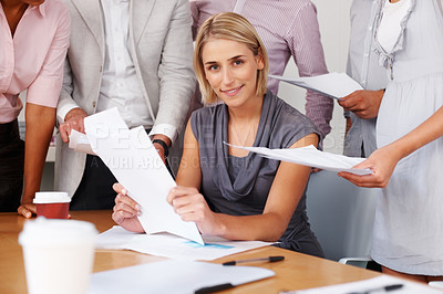 Buy stock photo Happy woman with team working with documents at meeting