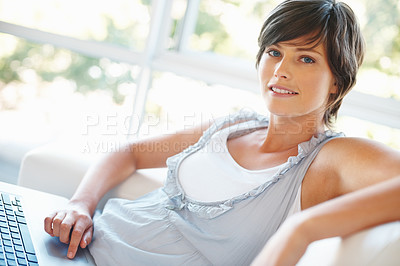 Buy stock photo Confident young woman with laptop sitting on couch