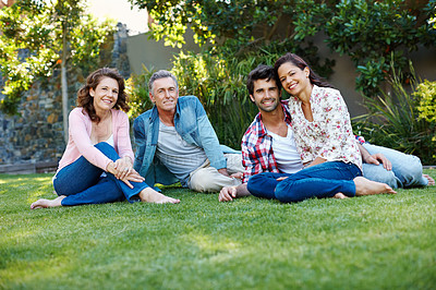 Buy stock photo A young couple spending time in the park with their in-laws