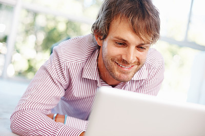 Buy stock photo Closeup portrait of confident young man using laptop at home