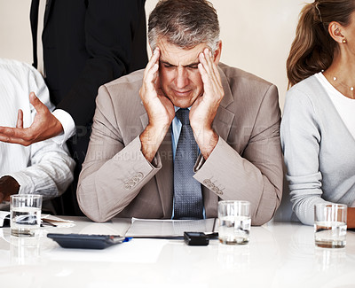 Buy stock photo Portrait of a stressed businessman getting headache during a meeting with his business colleague - Office