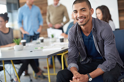 Buy stock photo Shot of a handsome young man sitting in a meeting