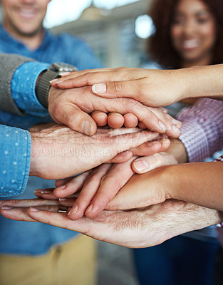 Buy stock photo Closeup shot of co-workers hand put together in an expression of unity and team spirit