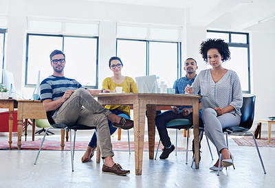 Buy stock photo Portrait of a group of young designers at work in an office