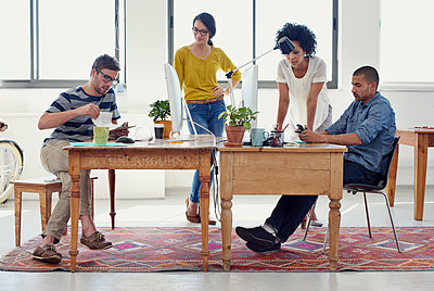 Buy stock photo Shot of a group of creative professionals working in an office