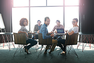 Buy stock photo Portrait of a group of office colleagues sitting around a boardroom table