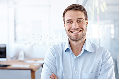 Buy stock photo Portrait of a confident young design professional standing in an office with his arms crossed