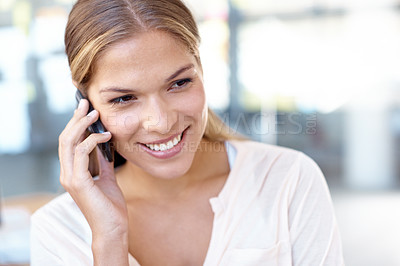 Buy stock photo Closeup shot of a young business professional talking on her cellphone